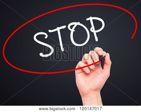 Man Hand Writing Stop With Black Marker On Visual Screen.
