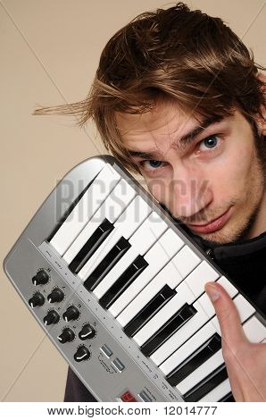 Young Man Holding His Midi Keyboard