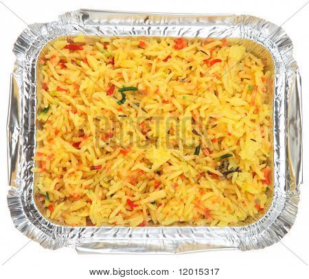Indian pilau rice in takeaway foil container.