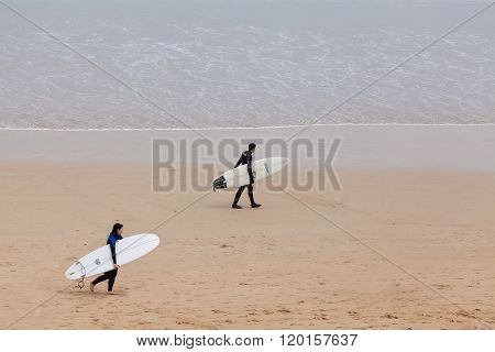 Surfers at the beach in Torquay, Australia