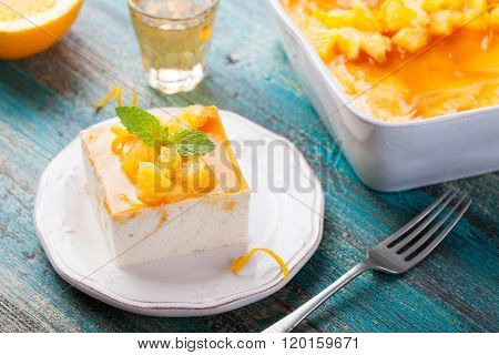 Cheesecake, cottage cheese pudding with fresh oranges and orange marmalade, jam glaze on a white pla