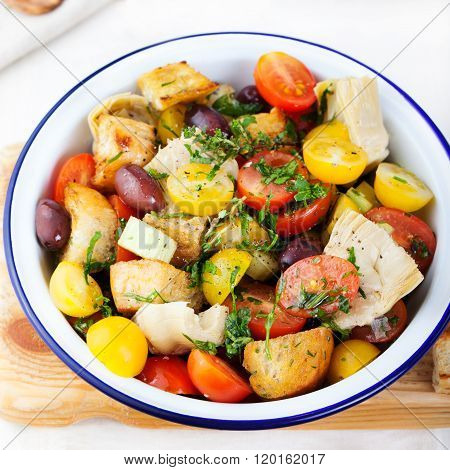 Traditional healthy Panzanella salad with fresh tomatoes Top view