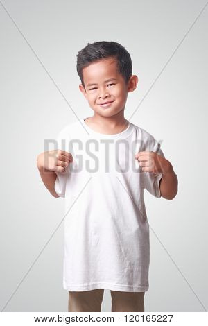 Little Asian Boy Showing His White Shirt
