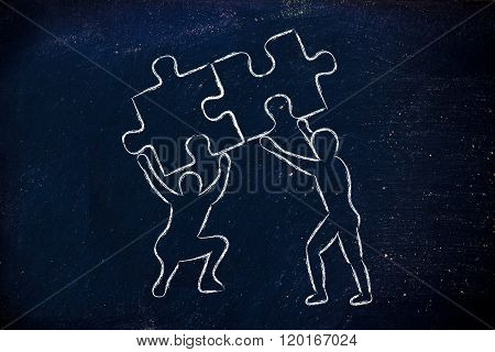 People Lifting Matching Pieces Of Puzzle