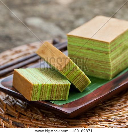 Traditional Indonesian sweet Layer cake Wooden background