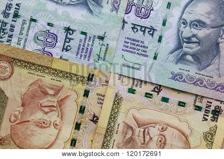 Detail of Indian Rupee banknotes on a table