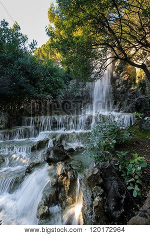 Waterfall In Wild Forest Paradise Landscape. Vertical Photography.