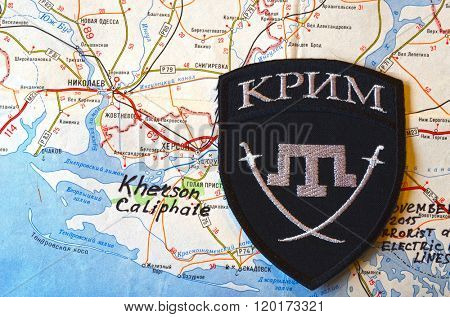 Kiev,Ukraine.FEB 20 Chevron of Islamic extremist formation Crimea. Background map of Kherson Caliphate on February 20,2016 in Kiev, Ukraine