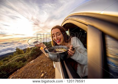 Woman eating in the car