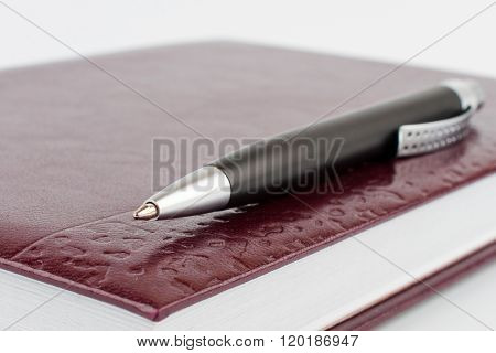 Black Ballpoint Pen On A Notebook Cover