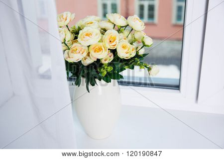 Bunch Of Beautiful Rose Flowers In Ceramic Vase On A Window