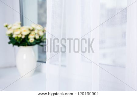 White Cotton Curtain And Flowers On The Window