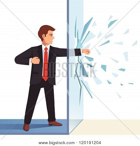Businessman breaking through invisible glass wall