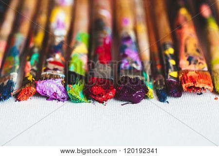 Artist Paintbrushes Closeup On Artistic Canvas. Selective Focus.