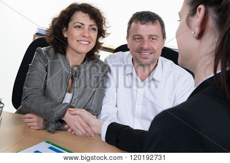 Mid Aged Couple Meeting Financial Adviser For Investment
