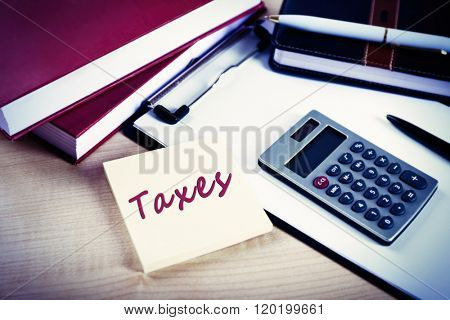 Taxes folder with office tools on the table