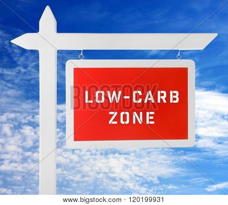 Low-Carb Zone text on wooden pointer on cloudy sky background