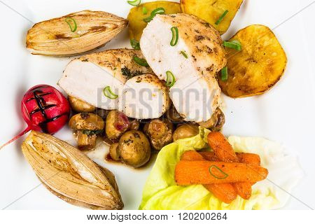 Chicken With Sauteed Mushrooms, Shallots And Glazed Baby Carrots