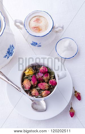 Cup of pink dry roses tea