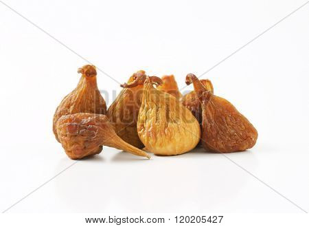 sun dried figs on white background