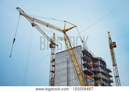 Tower Cranes On The Construction Site