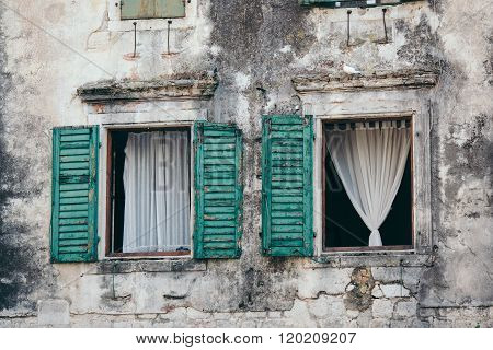 Wooden window shutters - Opened old shuttered weathered wooden window in the Kotor, Montenegro