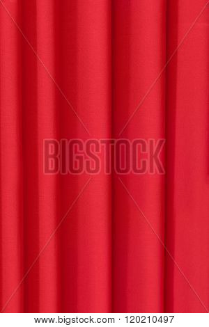 The background is draped in bright red cloth