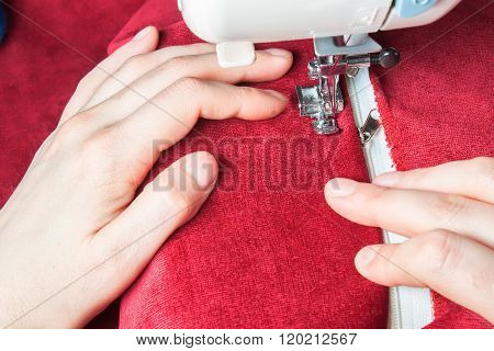 Sewing Machine, Red Fabric And Women's Hands
