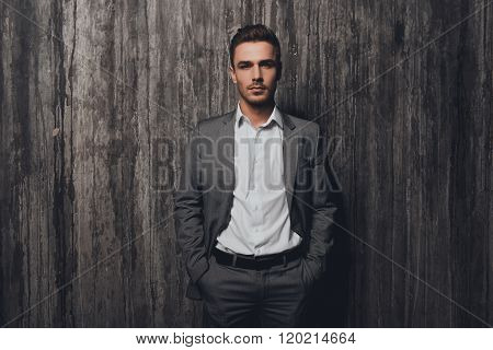 Handsome Businessman In Gray Suit Holding Hands In Pockets