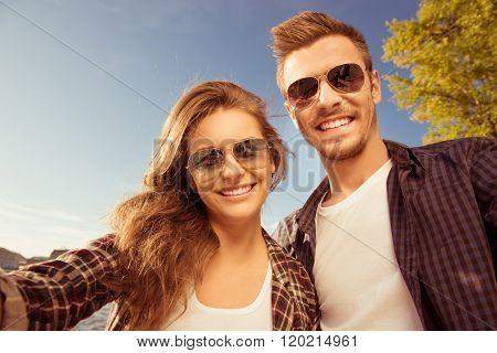 Happy Couple In Love In Glasses Making Selfie