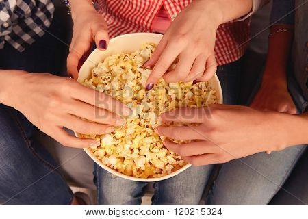 Close Up, Top View Photo Of Women's Hands Taking Popcorn