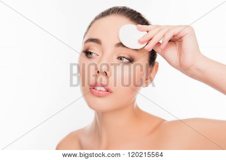 Portrait Of Attractive Young Woman Washing Off Makeup With Cotton Pad