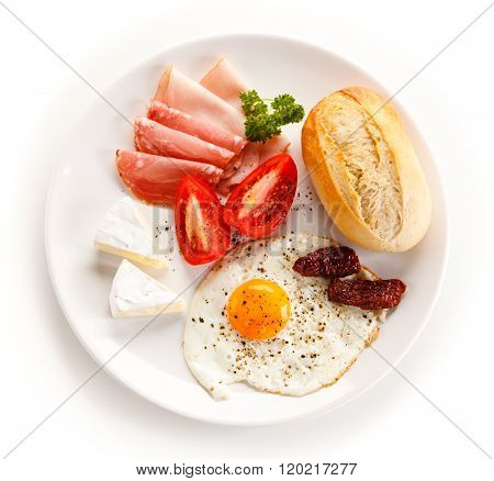 Breakfast - fried egg, bacon, cheese and vegetables