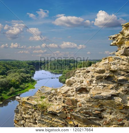 Ruins of the Gubkiv castle at the edge of the hill with a view on river scape Ukraine