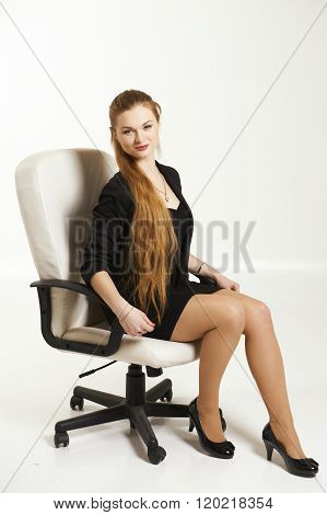 Young  business woman sitting on chair