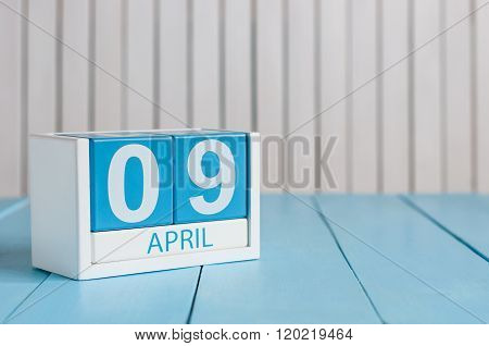 April 9th. Image of april 9 wooden color calendar on white background.  Spring day, empty space for