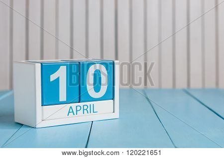 April 10th. Image of april 10 wooden color calendar on white background.  Spring day, empty space fo