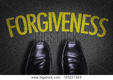 Top View of Business Shoes on the floor with the text: Forgiveness