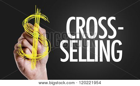 Hand writing the text: Cross-Selling