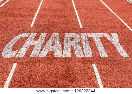 Charity written on running track