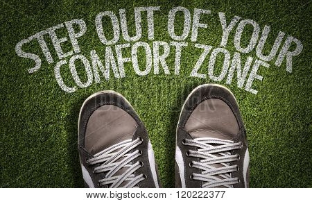 Top View of Sneakers on the grass with the text: Step Out Of Your Comfort Zone