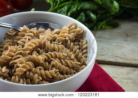 Healthy Wholemeal Pasta, Spiral Noodles From Whole Grain Spelt In A Bowl On A Rustic Wooden Table, R