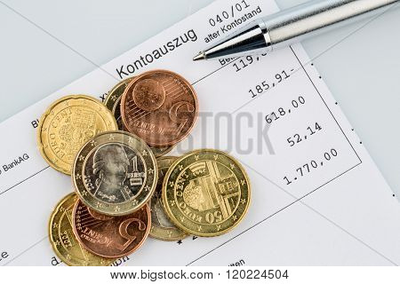 account statement and coins