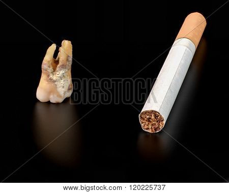 Cigarette And Tooth On A Black Background