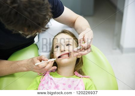 Child Patient On Her Regular Dental Checkup