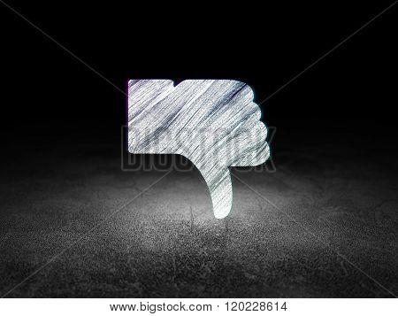 Social media concept: Thumb Down in grunge dark room