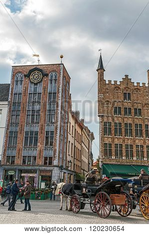 Horse-drawn Carriage With Tourists In Grote Markt, Bruges, Belgium