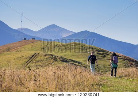 Cute Couple Walking On Nill On Muntain Background