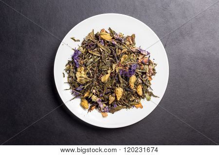 Macabeo Tea On White Plate On Dark Backgroung