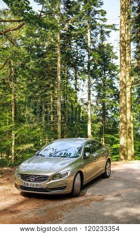 Electric Volvo Limousine In Forest